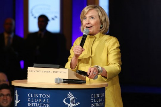 Hillary Clinton prepares to juggle microphones for money. (AP)