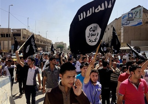 Demonstrators chant pro-al-Qaida-inspired Islamic State of Iraq and the Levant (ISIL) as they carry al-Qaida flags in front of the provincial government headquarters in Mosul