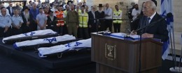 Israeli President Shimon Peres, right, eulogizes the three Israeli teens who were abducted and killed in the occupied West Bank