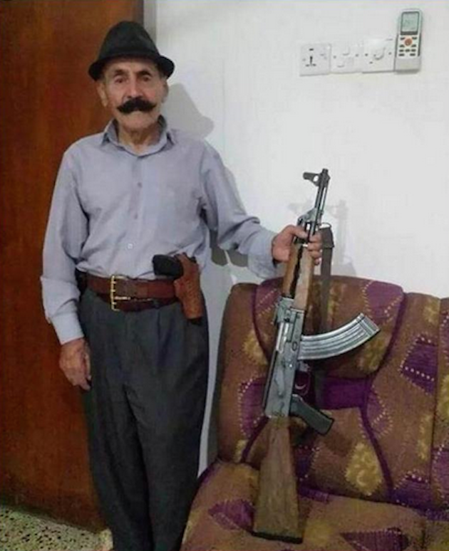WFB ombudsman Biff Diddle poses with an AK-47 near Erbil, Kurdistan. (AP)