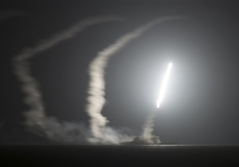 In this photo released by the U.S. Navy, the guided-missile cruiser USS Philippine Sea launches a Tomahawk cruise missile at Islamic State group positions in Syria