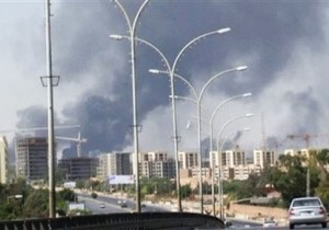 In this image made from video by The Associated Press, smoke rises from the direction of Tripoli airport in Tripoli, Libya, Sunday, July 13, 2014. Rival militias battled Sunday for the control of the international airport in Libya's capital