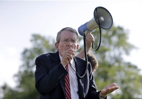 Jeff Bell uses a bullhorn to address a gathering in Cherry Hill, N.J / AP