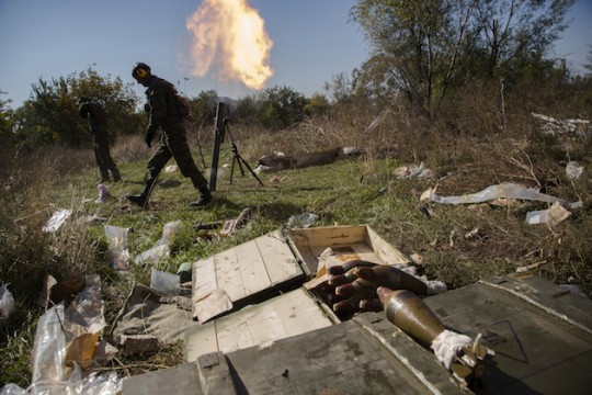 """Russian """"rebels"""" fire conduct peaceful mortar fire to celebrate the success of the Russian-brokered ceasefire. (AP)"""