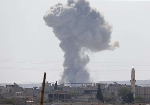 Smoke rises after an U.S.-led air strike in the Syrian town of Kobani Ocotber 9