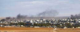 Smoke rises from the Syrian town of Kobani, seen from near the Mursitpinar crossing on the Turkish-Syrian border in the southeastern town of Suruc in Sanliurfa province, October 20,