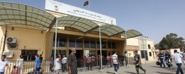 Libyans walk toward the departure hall in Benghazi airport, in Libya, Friday, Sept. 14, 2012