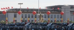 Chinese People's Liberation Army missile carrier trucks drive past the Tiananmen Square during a military parade