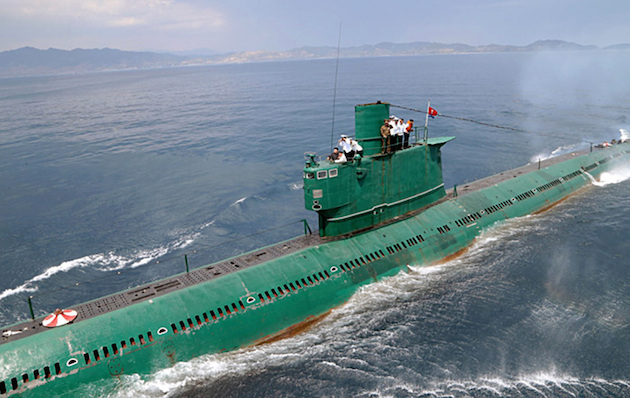 "Dear Leader Kim-Jong Un riding one of North Korea's Romeo Class Submarines. North Korea currently ""maintains"" the largest arsenal of submarines, with a total of 70 vessels estimated under their control"