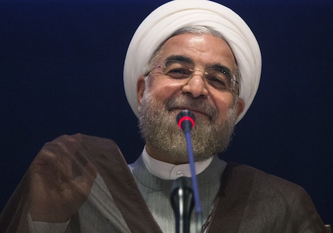 Iran's President Hassan Rouhani smiles while replying to a question during a news conference on the sidelines of the 69th United Nations General Assembly at United Nations Headquarters in New York September 26