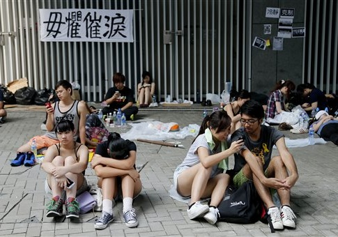 Student activists wait on the streets near the government headquarters, Thursday, Oct. 2