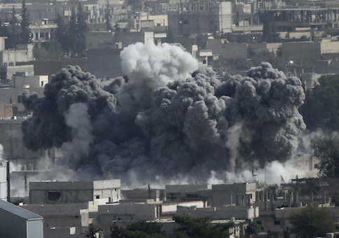 Smoke rises from the Syrian town of Kobani