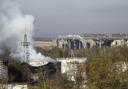 Smoke rises near the damaged main terminal of the Donetsk Sergey Prokofiev International Airport during fighting between pro-Russian rebels and Ukrainian government forces in Donetsk, eastern Ukraine, October 4