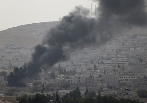 Smoke rises in the Syrian town of Kobani, as seen from the southeastern town of Suruc near the Mursitpinar border crossing on the Turkish-Syrian border October 10