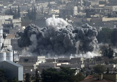 Smoke rises from the Syrian town of Kobani, seen from near the Mursitpinar border crossing