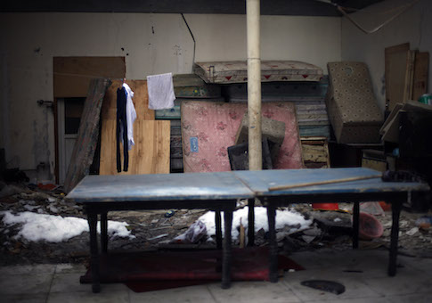 Wet mattresses are stacked inside the site of a former black jail where a young woman claims she was raped while being illegally detained in Beijing, China / AP