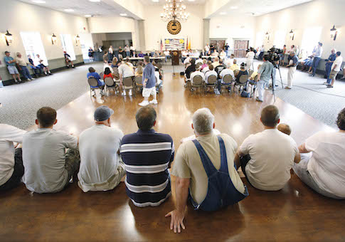 Workers gather at the United Auto Workers union hall in Spring Hill, Tenn. / AP