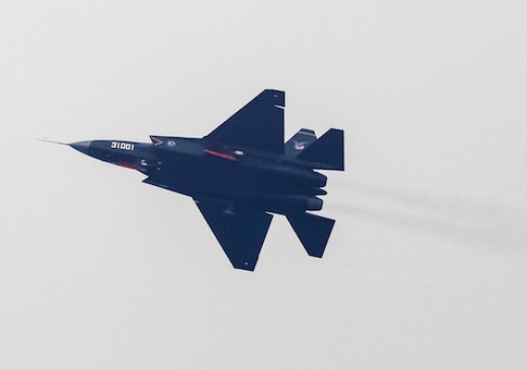 A J-31 stealth fighter of the Chinese People's Liberation Army Air Force is seen during a test flight ahead of the 10th China International Aviation and Aerospace Exhibition in Zhuhai, Guangdong province, November 10, 2014