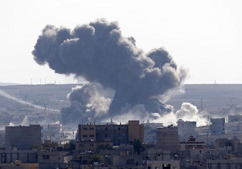 An explosion following an air strike is seen in central Kobani November, 10 2014