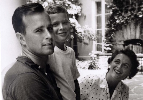 George W. Bush is shown with his father, George Bush and mother, Barbara Bush in Rye, New York, in this file photo taken during the summer of 1955