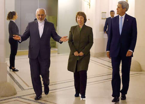 U.S. Secretary of State John Kerry (R), Iranian Foreign Minister Javad Zarif (L) and EU envoy Catherine Ashton arrive for a meeting in Vienna November 20