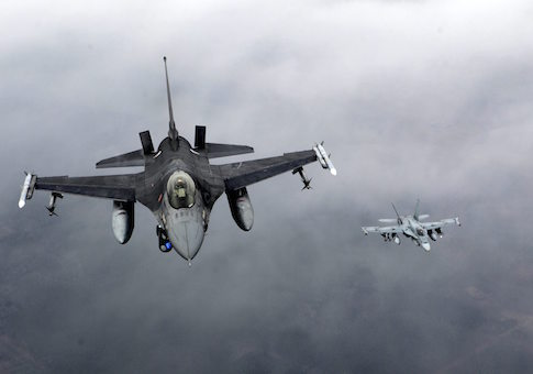 Portuguese Air Force fighter F-16 (L) and Canadian Air Force fighter CF-18 Hornet patrol over Baltics air space