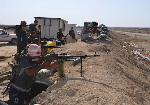 Tribal fighters take part in an intensive security deployment against Islamic State militants in Haditha October 25
