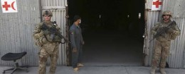 U.S. troops stand guard in front of a police medical warehouse in Kabul