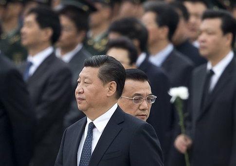 Chinese Premier Li Keqiang, right, walks past Chinese President Xi Jinping