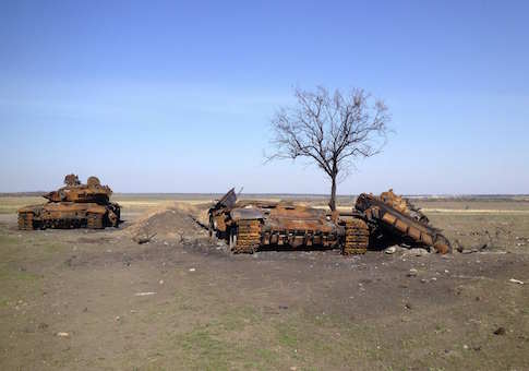 Two destroyed T-72 tanks, which presumably came from Russia, are seen on a battlefield near separatist-controlled Starobesheve in eastern Ukraine October 2