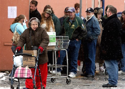 People line up at the County Food Bank in Olympia, Wash. / AP