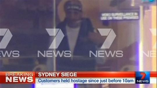 Sydney terrorist filmed through cafe window / AP Images