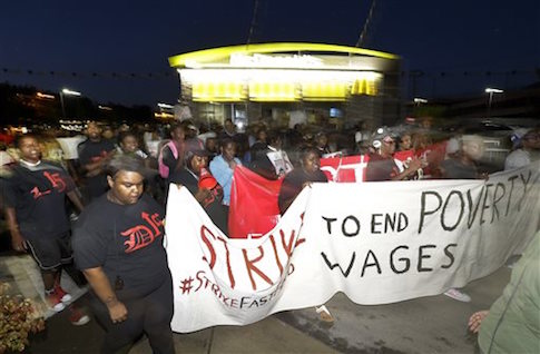 Protesters march on a McDonalds restaurant in Detroit / AP