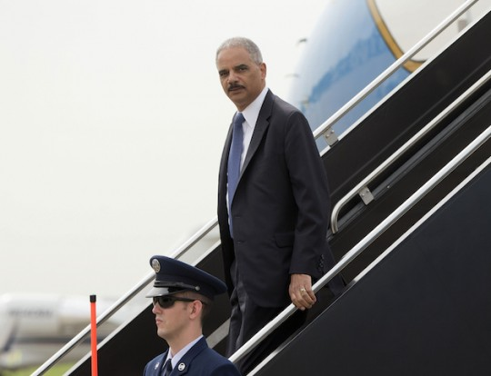Eric Holder disembarks from a TAXPAYER-FUNDED airplane. (AP)