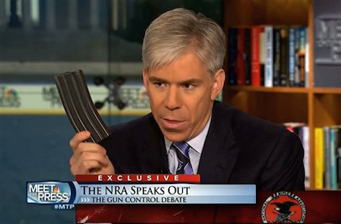David Gregory holding a high-capacity ammunition magazine on Meet the Press in 2012 / AP