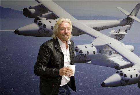 The Economist brought in Richard Branson, seen at the  Virgin Galactic hangar, to help forecast 2014 / AP