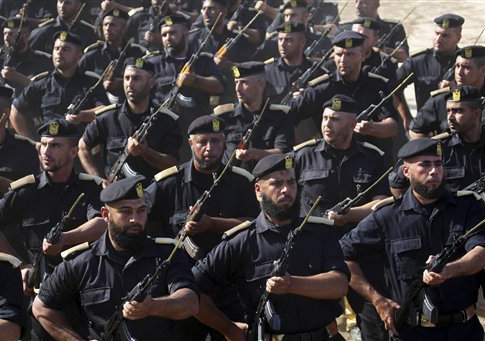 Members of Palestinian Hamas security forces march during their graduation ceremony at the fisherman's port in Gaza City