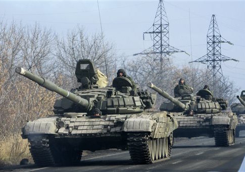 Pro-Russian rebel military vehicles convoy move towards Donetsk , Eastern Ukraine, Monday, Nov. 10
