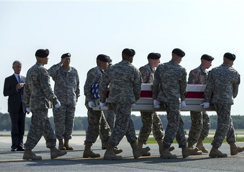 Secretary of the Army John McHugh, left, and Army Chief of Staff Gen. Ray Odierno, third from left, watch an Army carry team transfers the remains of Army Maj. Gen. Harold Greene at Dover Air Force Base, Del., Thursday, Aug. 7, 2014