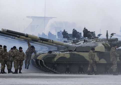 Ukrainian soldiers get new tanks and other military vehicles at a military base in the eastern town of Chuguyev, Ukraine
