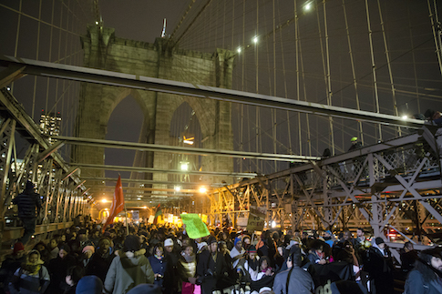 Protesters march across the Brooklyn Bridge / AP