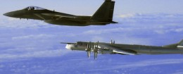"This Thursday, Sept. 28, 2006 file photo provided by the U.S. Air Force shows an F-15C Eagle from the 12th Fighter Squadron at Elmendorf Air Force Base in Anchorage, Alaska, flying next to a Russian Tu-95 ""Bear"" bomber, right, during a Russian exercise which brought the bomber near the west coast of Alaska"