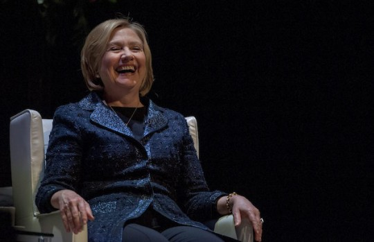 Hillary Clinton laughs during a forum hosted by a Canadian bank accused of helping Enron commit fraud. (AP)