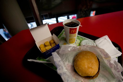 A Quarter Pounder meal is served with arepas or corn cakes at a local McDonald's, in Caracas, Venezuela. / AP
