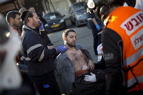 Paramedics treat victim of stabbing in Tel Aviv, Israel / AP