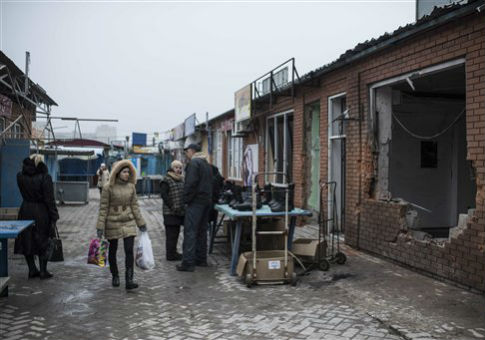A woman visits a market in the Mariupol, which was recently attacked by Russia-backed separatists. / AP