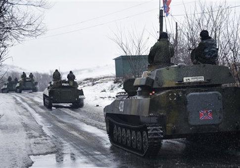 A pro-Russian armored vehicle moves toward Slovyanoserbsk, eastern Ukraine, Wednesday, Jan. 21, 2015