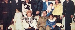 Raghad, in the blue blazer, holds her baby in this photograph of the Saddam Hussein family from 1980s