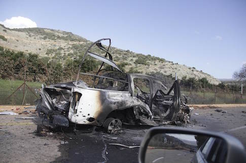 A burnt vehicle is seen near the village of Ghajar on Israel's border with Lebanon January 28, 2015