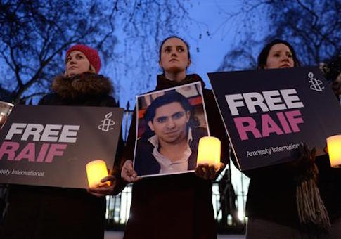 Raif Badawi protest. Protesters during an Amnesty International candle-lit protest vigil for blogger and free speech activist Raif Badawi outside the Saudi Arabia Embassy. In Mayfair, London